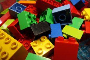Colorful plastic building blocks, fair use image from https://pixabay.com/en/lego-blocks-duplo-lego-colorful-2458575/