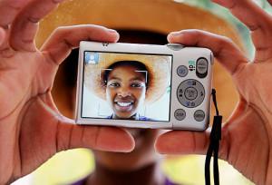 Girl taking photograph