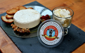 Photo of cheese plate with Lucky Penny logo