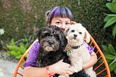 Woman hugging 2 dogs